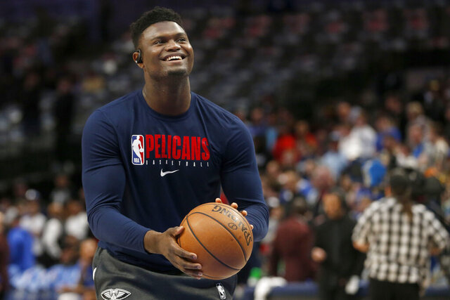 FILE - In this March 4, 2020, file photo, New Orleans Pelicans forward Zion Williamson shoots free throws prior to an NBA basketball game against the Dallas Mavericks in Dallas. Pelicans rookie Williamson says he feels like he is in good shape as he prepares to help lead New Orleans' eight-game push to make the NBA playoffs. (AP Photo/Michael Ainsworth)