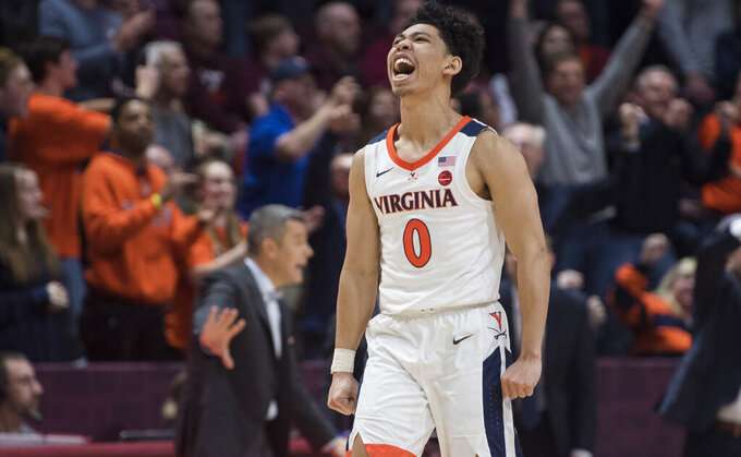 Virginia guard Kihei Clark (0) celebrates his go-ahead 3-pointer against Virginia Tech in the closing seconds of an NCAA college basketball game against Virginia Tech in Blacksburg, Va., Wednesday, Feb. 26, 2020. (AP Photo/Lee Luther Jr.)