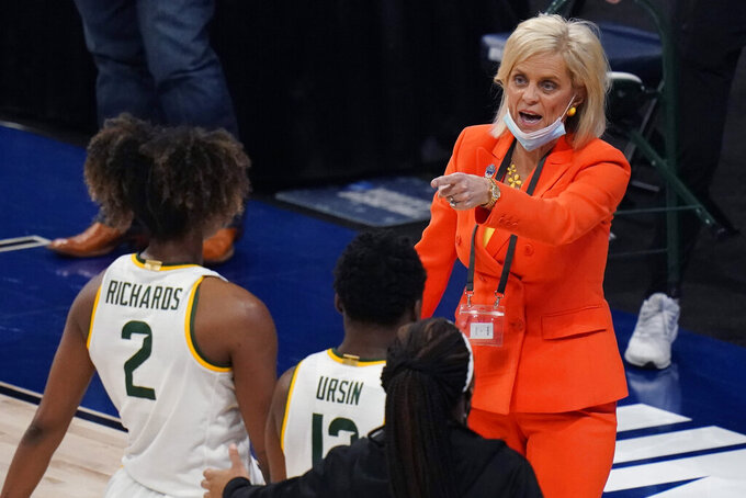 Baylor head coach Kim Mulkey, right, talks to her players during the first half of a college basketball game against Michigan in the Sweet Sixteen round of the women's NCAA tournament at the Alamodome in San Antonio, Saturday, March 27, 2021. (AP Photo/Eric Gay)