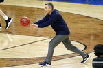 Virginia head coach Tony Bennett passes the ball during a practice session for the semifinals of the Final Four NCAA college basketball tournament, Friday, April 5, 2019, in Minneapolis. (AP Photo/Matt York)