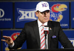 FILE - In this Nov. 18, 2018, file photo, University of Kansas football coach Les Miles makes a statement during a news conference in Lawrence, Kan.  Les Miles has plenty of experience taking over floundering Big 12 football programs, having done so once at Oklahoma State. But he faces an enormous rebuilding job at Kansas, where there hasn't been a winning season since 2008. (AP Photo/Orlin Wagner, File)