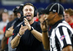 FILE - In this Nov. 25, 2016, file photo, Texas Tech head coach Kliff Kingsbury, left, calls a timeout during the second half of an NCAA college football game against Baylor, in Arlington, Texas. Kingsbury has been treading water at his alma mater, with an administration that wants him to be successful and a fan base that seems to cut him some extra slack. (AP Photo/Ron Jenkins, File)