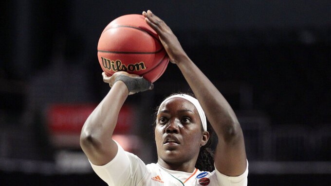 FILE - In this March 22, 2019 file photo, Miami forward Beatrice Mompremier (32) aims a free throw, during a first round women's college basketball game against FGCU, in the NCAA Tournament in Coral Gables, Fla. Mompremier was picked as the preseason player of the year after averaging 16.7 points and 12.2 rebounds and earning a spot on the all-ACC team in 2018-19. (AP Photo/Luis M. Alvarez, File)