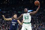 Boston Celtics guard Javonte Green (43) grabs a rebound against Dallas Mavericks forward Justin Jackson (44) during the first quarter of an NBA basketball game in Boston, Monday, Nov. 11, 2019. (AP Photo/Charles Krupa)