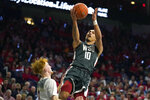 Washington State guard Isaac Bonton (10) drives past Arizona guard Nico Mannion in the first half of an NCAA college basketball game Thursday, March 5, 2020, in Tucson, Ariz. (AP Photo/Rick Scuteri)