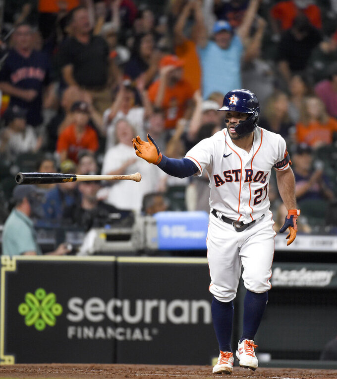 Houston Astros' Jose Altuve tosses his bat after hitting a solo home run during the third inning of the team's baseball game against the Cleveland Indians, Tuesday, July 20, 2021, in Houston. (AP Photo/Eric Christian Smith)