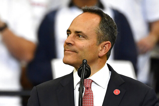 FILE - In this Nov. 4, 2019, file photo, Kentucky Gov. Matt Bevin, right, looks out at the crowd during a campaign rally with President Donald Trump in Lexington, Ky. Bevin, who lost to Democrat Andy Beshear last month in a close race, issued more than 400 pardons since the Nov. 5 election, according to the Kentucky Secretary of State's office.  (AP Photo/Timothy D. Easley, File)