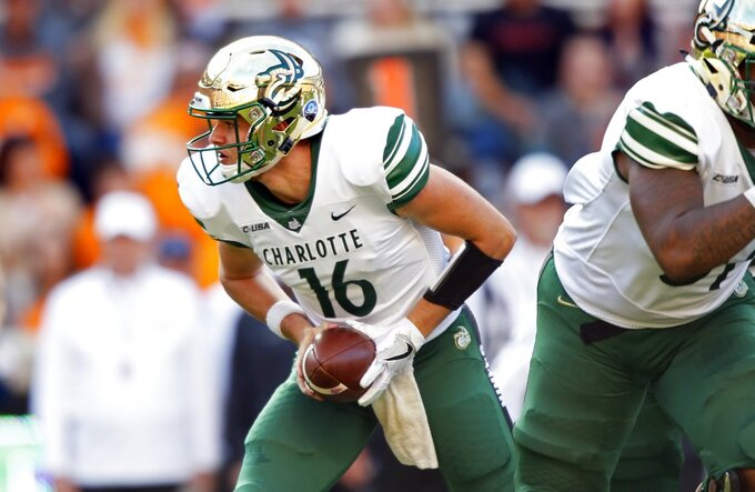Charlotte quarterback Evan Shirreffs (16) hands the ball off in the first half of an NCAA college football game against Tennessee Saturday, Nov. 3, 2018, in Knoxville, Tenn. (AP Photo/Wade Payne)
