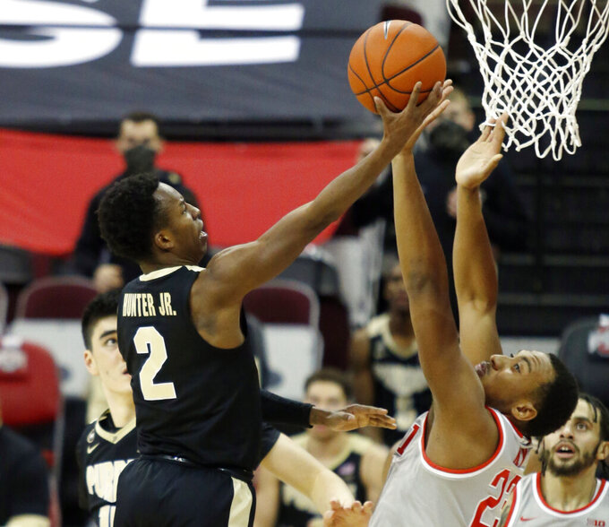Purdue guard Eric Hunter, left, goes up for a shot against Ohio State forward Zed Key during the second half of an NCAA college basketball game in Columbus, Ohio, Tuesday, Jan. 19, 2021. (AP Photo/Paul Vernon)