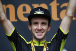 Britain's Simon Yates celebrates on the podium after winning the twelfth stage of the Tour de France cycling race over 209,5 kilometers (130 miles) with start in Toulouse and finish in Bagneres-de-Bigorre, France, Thursday, July 18, 2019. (AP Photo/ Christophe Ena)
