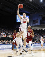 Belmont's Seth Adelsperger (50) shoots during the first half of a First Four game of the NCAA college basketball tournament against Temple, Tuesday, March 19, 2019, in Dayton, Ohio. (AP Photo/John Minchillo)