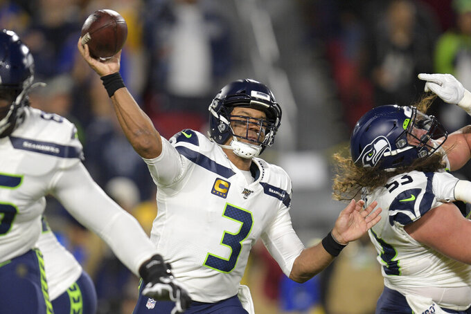 File-This Dec. 8, 2019, file photo shows Seattle Seahawks quarterback Russell Wilson passing during the first half of an NFL football game against the Los Angeles Rams in Los Angeles. No matter how many spectacular plays Lamar Jackson and Wilson made, officiating overshadowed the NFL this season. (AP Photo/Kyusung Gong, File)