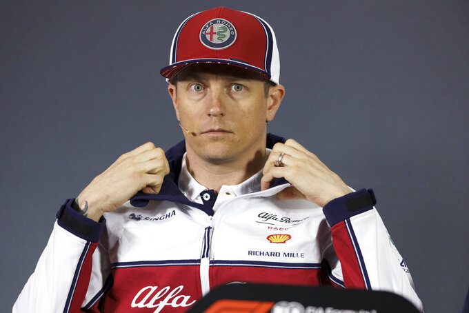 Alfa Romeo driver Kimi Raikkonen of Finland adjusts his jacket collar during a press conference at the Shanghai International Circuit ahead of the Chinese Formula One Grand Prix in Shanghai, China, Thursday, April 11, 2019. (AP Photo/Ng Han Guan)
