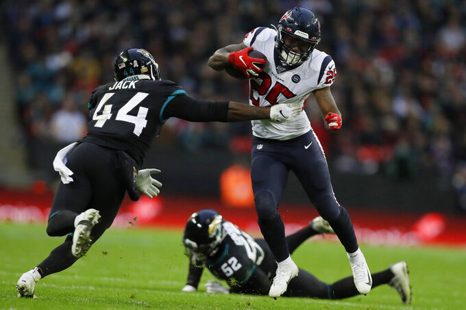 Jacksonville Jaguars middle linebacker Myles Jack (44) misses the tackle on Houston Texans running back Duke Johnson (25) during the second half of an NFL football game at Wembley Stadium, Sunday, Nov. 3, 2019, in London. (AP Photo/Kirsty Wigglesworth)