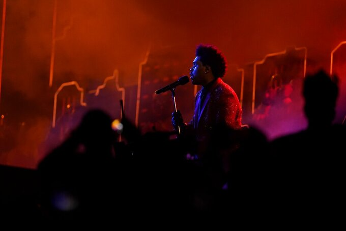 The Weeknd performs during halftime of the NFL Super Bowl 55 football game between during the halftime show of the NFL Super Bowl 55 football game between the Kansas City Chiefs and Tampa Bay Buccaneers, Sunday, Feb. 7, 2021, in Tampa, Fla. (AP Photo/Mark Humphrey)