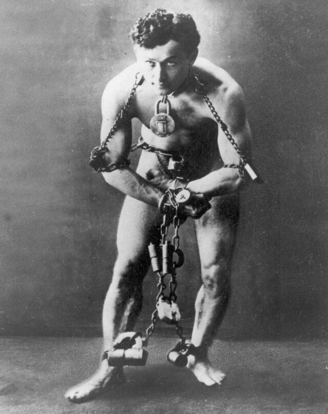 FILE - This circa 1899, file photo, shows escape artist Harry Houdini in chains. The Philadelphia-based National Museum of American Jewish History announced on Thursday, Oct. 22, 2020, it will induct illusionists Harry Houdini and David Copperfield into its hall of fame on Dec. 12.The museum says the award recognizes the achievements and contributions of American Jews