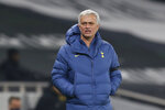 Tottenham's manager Jose Mourinho watches the play during a Group J Europa League soccer match and between Tottenham Hotspur and Ludogorets at the Tottenham Hotspur stadium in London, England, Thursday Nov. 26, 2020. (Ian Kington/Pool via AP)
