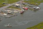 In this aerial photo, damage from Hurricane Ida is seen, Monday, Sept. 6, 2021, in Golden Meadow, La. (AP Photo/Matt Slocum)