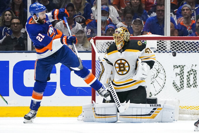 Boston Bruins goaltender Tuukka Rask (40) stops a shot on goal by New York Islanders' Kyle Palmieri (21) during the first period of Game 6 during an NHL hockey second-round playoff series Wednesday, June 9, 2021, in Uniondale, N.Y. (AP Photo/Frank Franklin II)