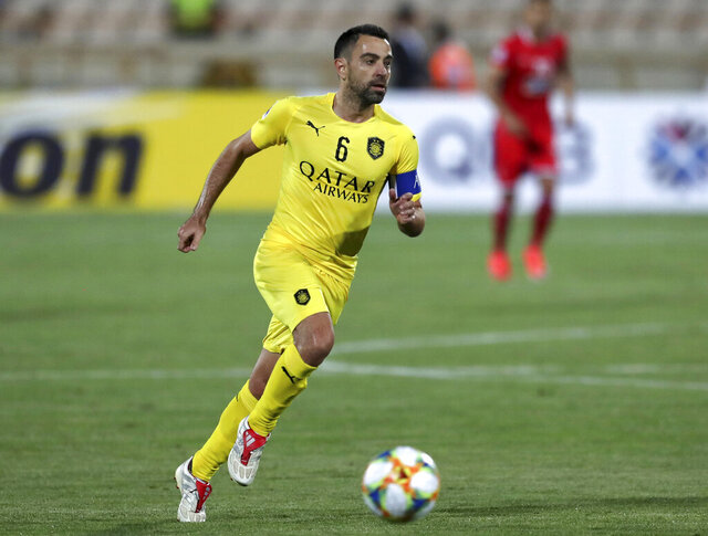 FILE - In this file photo dated Monday, May 20, 2019, Qatar's Al-Sadd player Xavi Hernandez, former Barcelona and Spain midfielder, during an AFC Champions League match at the Azadi stadium in Tehran, Iran.  40-year old Xavi Hernandez has tested positive for the COVID-19 coronavirus, according to an announcement Saturday July 25, 2020. (AP Photo/Vahid Salemi, FILE)
