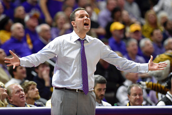 LSU coach Will Wade voices his displeasure about a foul called on one of the team's players during the first half of an NCAA college basketball game against Kentucky, Tuesday, Feb. 18, 2020, in Baton Rouge, La. (AP Photo/Bill Feig)