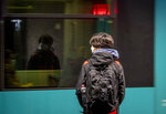 A pupil waits for a subway train in Frankfurt, Germany, Wednesday, Nov. 25, 2020. The German government will discuss further restrictions to avoid the outspread of the coronavirus. (AP Photo/Michael Probst)