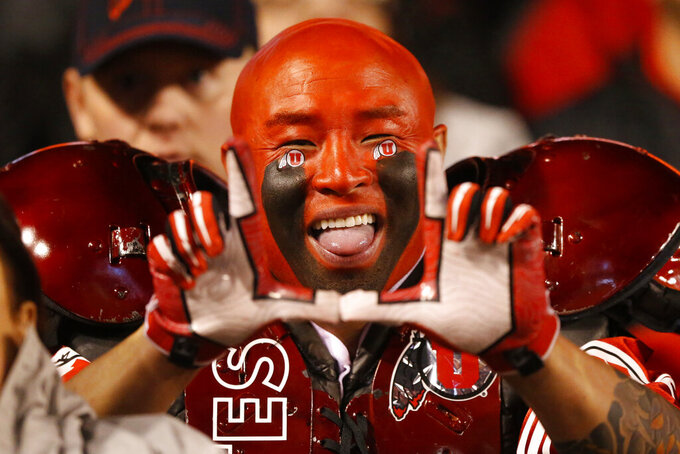 A Utah fan shows his support in the first half of an NCAA college football game against California Saturday, Oct. 26, 2019, in Salt Lake City. (AP Photo/Rick Bowmer)