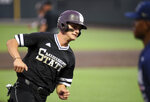 Mississippi State's Jake Mangum rounds third base on his way in to score against Vanderbilt in the third inning of an NCAA college baseball tournament super regional game Sunday, June 10, 2018, in Nashville, Tenn. (AP Photo/Mike Strasinger)