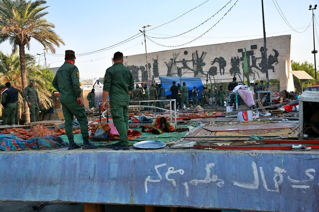 Security forces remove protesters' tents in Tahrir Square, Baghdad, Iraq, Saturday, Oct. 31, 2020. Iraqi security forces reopened Saturday Tahrir Square, the epicenter of the long-running anti-government protest movement and Al-Jumhuriyah Bridge, which was sealed off by protesters since the protests began in October last year. (AP Photo/Khalid Mohammed)