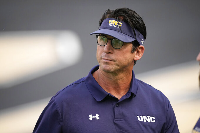 Northern Colorado head coach Ed McCaffrey looks on as his players warm up before an NCAA college football game against Colorado, Friday, Sept. 3, 2021, in Boulder, Colo. (AP Photo/David Zalubowski)