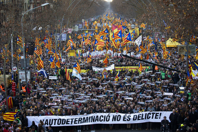 Pro independence demonstrators march waving esteladas or independence flags, during a demonstration supporting the imprisoned pro-independence political leaders in Barcelona, Spain, Saturday, Feb. 16, 2019. Thousands of Catalan separatists are marching in Barcelona to proclaim the innocence of 12 of their leaders who are on trial for their role in a failed 2017 secession bid. (AP Photo/Emilio Morenatti)