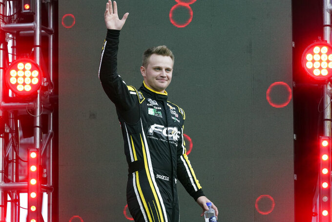 Justin Haley waves to fans during driver introductions before the NASCAR Cup Series auto race at Daytona International Speedway, Saturday, Aug. 28, 2021, in Daytona Beach, Fla. (AP Photo/John Raoux)