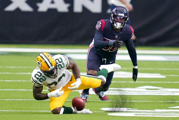 Green Bay Packers' Dexter Williams (22) is unable to recover a punt blocked by the Houston Texans as Texans linebacker Jonathan Greenard watches during the second half of an NFL football game Sunday, Oct. 25, 2020, in Houston. The Texans' Dylan Cole recovered the punt. (AP Photo/Sam Craft)