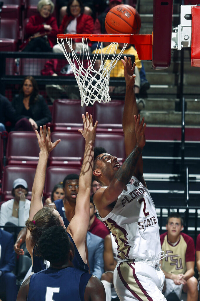 Florida State guard Anthony Polite (2) makes a layup in the second half of an NCAA college basketball game against North Florida in Tallahassee, Fla., Tuesday, Dec. 17, 2019. Florida State won 98-81. (AP Photo/Phil Sears)