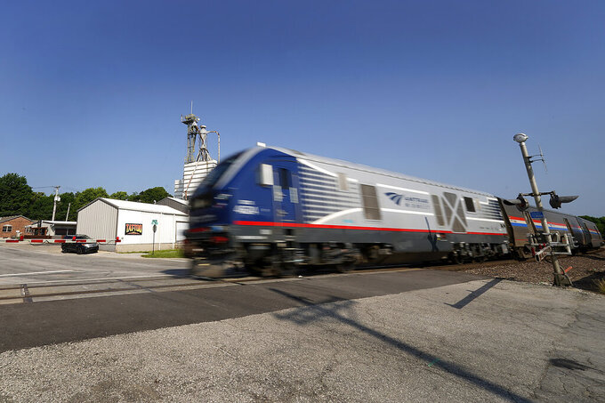 The Missouri River Runner Amtrak train leaves the station en route to St. Louis on Friday, June 11, 2021, in Lee's Summit, Mo. Backers of a proposal to expand passenger rail service through Kansas, Oklahoma and Texas hope the long-discussed package finally has a chance because of an anticipated influx of federal infrastructure funding. (AP Photo/Charlie Riedel)