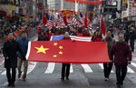 Participants march during the Lunar New Year parade in Manhattan's Chinatown neighborhood, in New York, Sunday, Feb. 9, 2020. (AP Photo/Craig Ruttle)