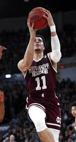 Mississippi State guard Quinndary Weatherspoon (11) attempts a shot in the first half of an NCAA college basketball game against Mississippi, Saturday, Jan. 12, 2019 in Starkville, Miss. (AP Photo/Rogelio V. Solis)