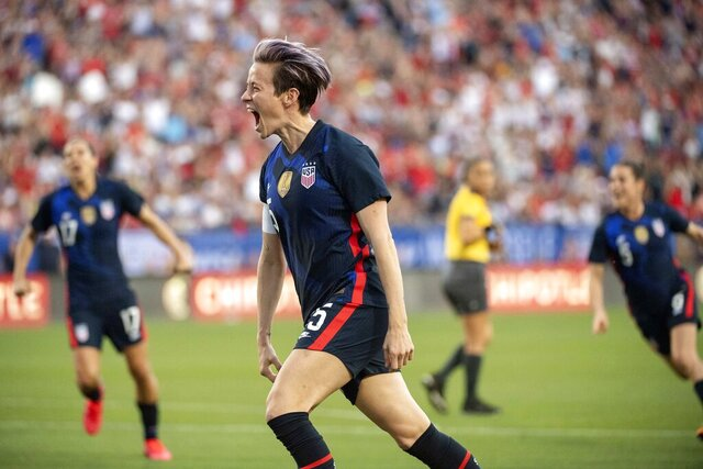 United States forward Megan Rapinoe (15) celebrates after scoring on a free kick against Japan during the first half of a SheBelieves Cup women's soccer match, Wednesday, March 11, 2020 at Toyota Stadium in Frisco, Texas. (AP Photo/Jeffrey McWhorter)