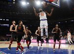 New York Knicks' Mitchell Robinson (26) dunks the ball in front of Cleveland Cavaliers' Jordan Clarkson (8) Ante Zizic (41) and Kevin Love during the first half of an NBA basketball game Thursday, Feb. 28, 2019, in New York. (AP Photo/Frank Franklin II)