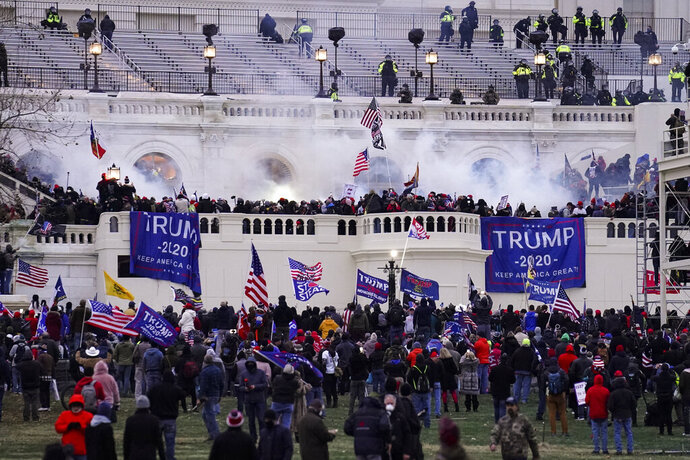 FILE - In this Jan. 6, 2021, file photo violent rioters, loyal to President Donald Trump, storm the Capitol in Washington. The words of Donald Trump supporters who are accused of participating in the deadly U.S. Capitol riot may end up being used against him in his Senate impeachment trial as he faces the charge of inciting a violent insurrection.  (AP Photo/John Minchillo, File)