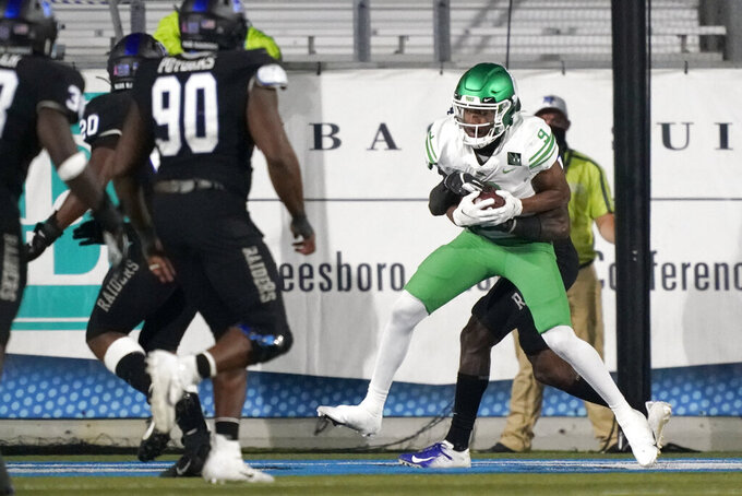 North Texas wide receiver Deonte Simpson (9) catches a touchdown pass against Middle Tennessee in the second half of an NCAA college football game Saturday, Oct. 17, 2020, in Murfreesboro, Tenn. (AP Photo/Mark Humphrey)