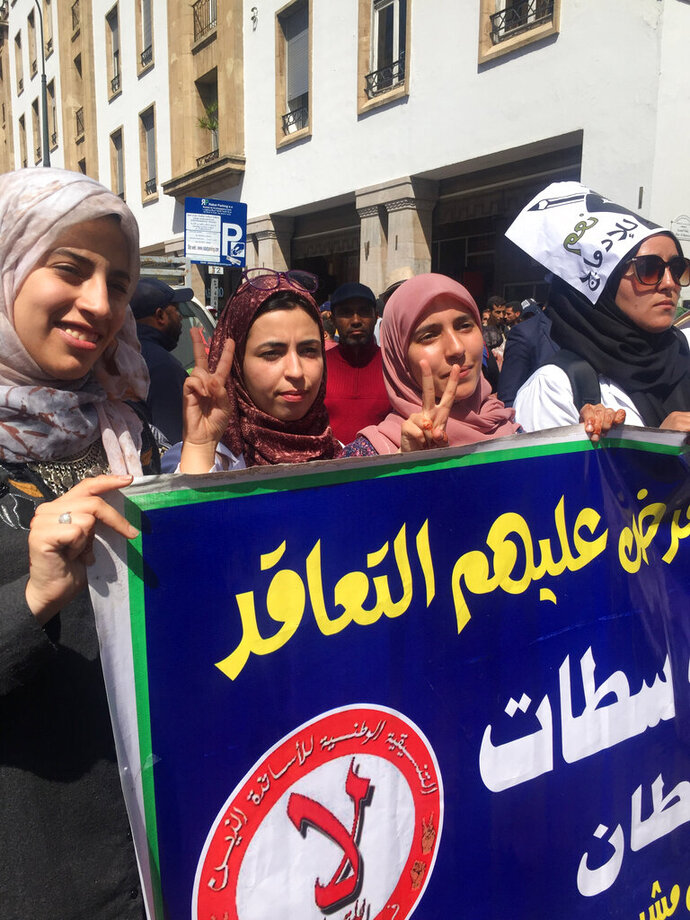 Several thousand Moroccan teachers carrying posters marched across the streets of Rabat, Morocco, Sunday March 24, 2019. The protesters demand respect for their profession and higher wages. The banner in arabic reads