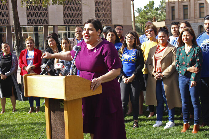 FILE - In this Feb. 21, 2020 file photo Democratic state Rep. Raquel Teran speaks at a news conference in Phoenix. The Maricopa County Board of Supervisors has chosen a sitting member of the Arizona House to replace a state senator who resigned after being charged with child molestation. The board chose Teran on Wednesday, Sept. 15, 2021, from a list of three candidates vetted by a citizen's panel to replace former Sen. Tony Navarrete. Supervisor Steve Gallardo announced the decision in a tweet. (AP Photo/Bob Christie, File)