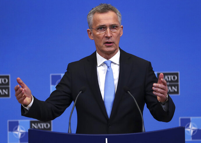 FILE - In this Feb. 14, 2019, file photo, NATO Secretary-General Jens Stoltenberg talks to journalists during a news conference at the second day of a NATO defense ministers meeting at NATO headquarters in Brussels. Leaders of both parties are inviting Stoltenberg to address a joint meeting of Congress next month around the 70th anniversary of the trans-Atlantic alliance (AP Photo/Francisco Seco, File)