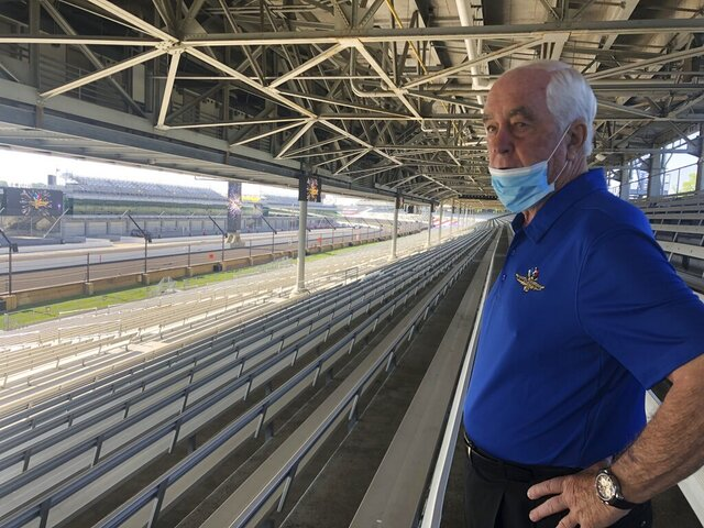 Roger Penske looks over the track from the grandstand at Indianapolis Motor Speedway in Indianapolis, Thursday, July 2, 2020. Penske has spent the six months since he bought Indianapolis Motor Speedway transforming the facility. He's spent millions on capital improvements to the 111-year-old national landmark and finally gets to showcase some of the upgrades this weekend as NASCAR and IndyCar share the venue in a historic doubleheader. (AP Photo/Jenna Fryer)