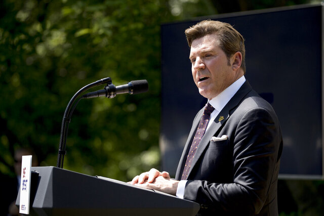 FILE - Former Fox News host Eric Bolling speaks during a one year anniversary event for the first lady's Be Best initiative in the Rose Garden of the White House on May 7, 2019, in Washington. The Sinclair Broadcast Group says it is ending its