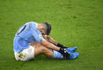 Manchester City's Sergio Aguero after taking a tumble during the English Premier League soccer match between Manchester City and Newcastle United at the Etihad stadium in Manchester, Saturday, Dec. 26, 2020. (Peter Powell/Pool via AP)