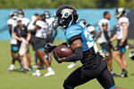 Jacksonville Jaguars wide receiver Tavon Austin runs after a reception during an NFL football practice, Saturday, Aug. 7, 2021, in Jacksonville, Fla. (AP Photo/John Raoux)