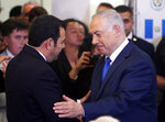 Israel Prime Minister Benjamin Netanyahu shakes hands with Guatemala President Jimmy Morales, left, during the dedication ceremony of the Guatemala Embassy in Jerusalem, Israel, Wednesday May 16, 2018. (Ronen Zvulun/Pool via AP)