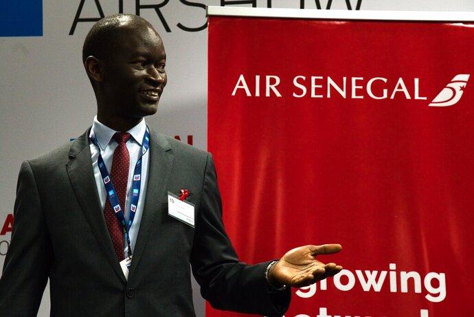 Air Senegal CEO Ibrahima Kane gestures before the start of a news conference at the Dubai Airshow in Dubai, United Arab Emirates, Tuesday, Nov. 19, 2019. Air Senegal said Tuesday it will purchase eight Airbus A220 aircraft. (AP Photo/Jon Gambrell)